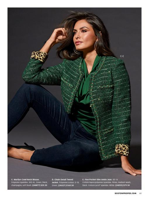 model wearing a green chain detail tweed jacket, green cowl neck top, and jeans.