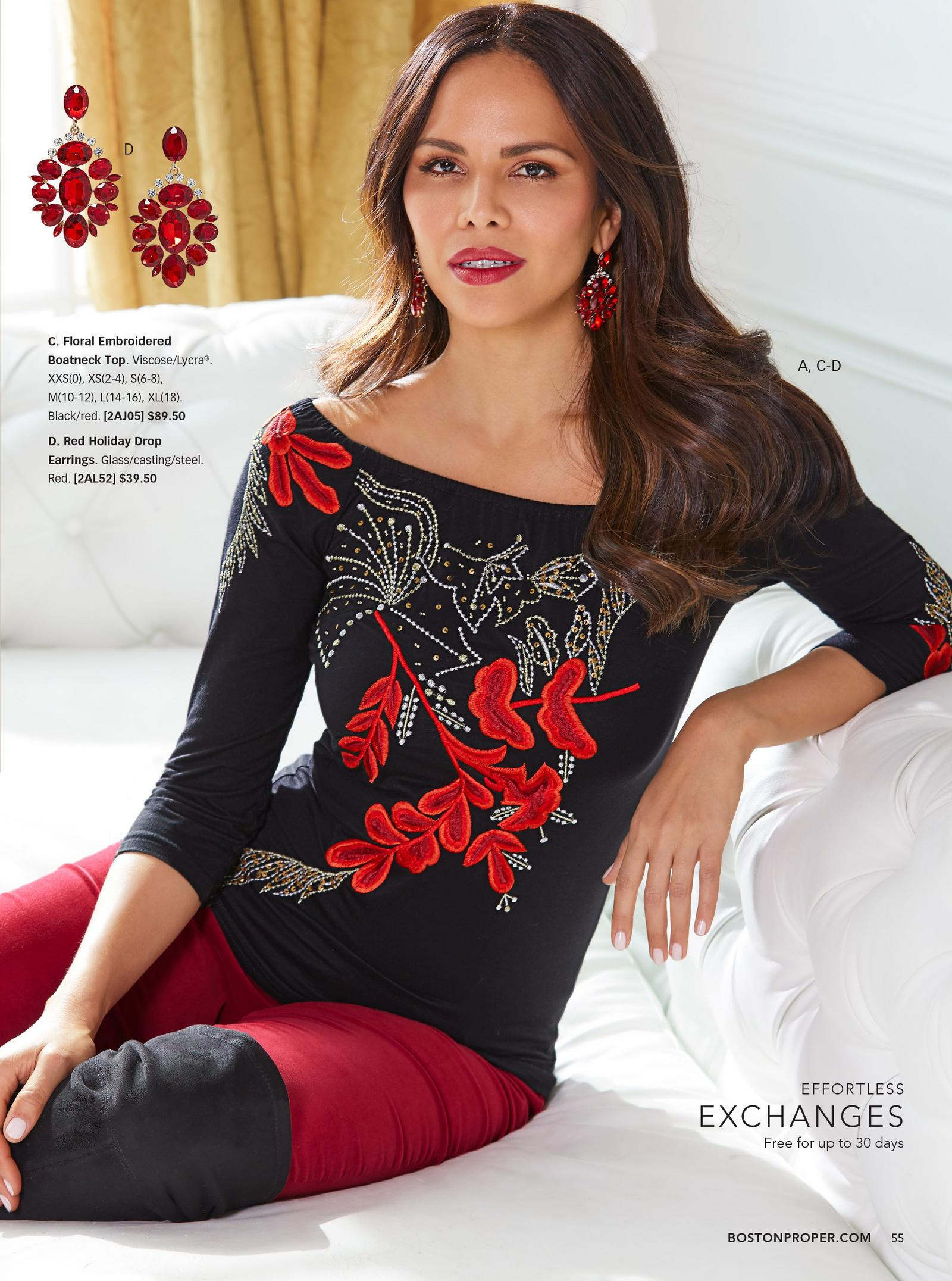 model wearing black and red floral embroidered boatneck top with red velvet pants, red earrings, and black over-the-knee boots.