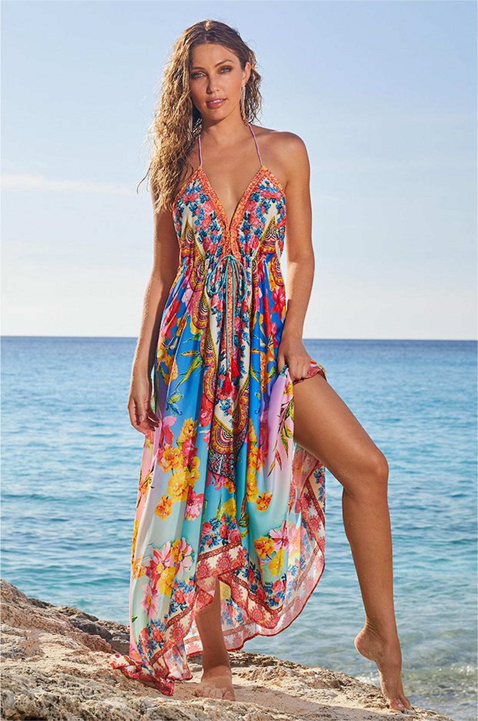 model standing on a rock wearing a multicolored floral maxi dress.