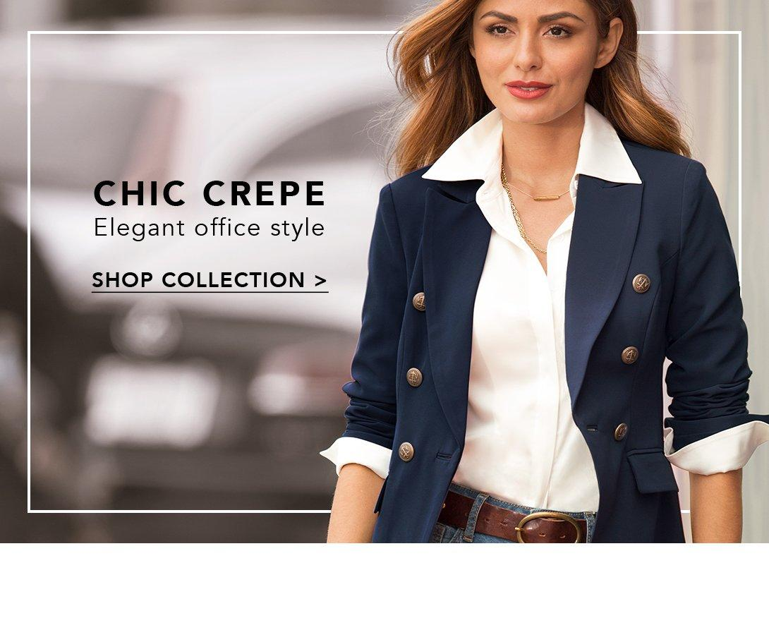 model wearing double breasted blazer in navy and white button up top.