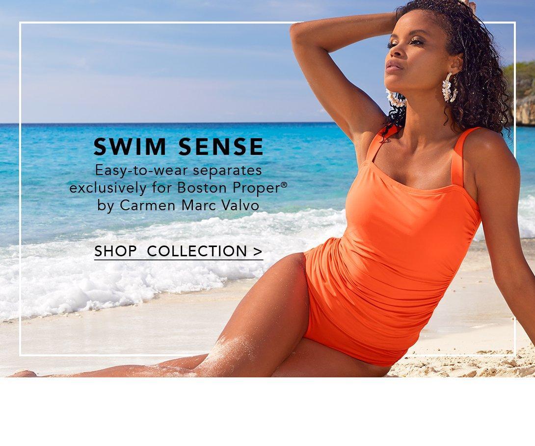 model wearing coral tankini with coral high-waisted bikini bottoms.