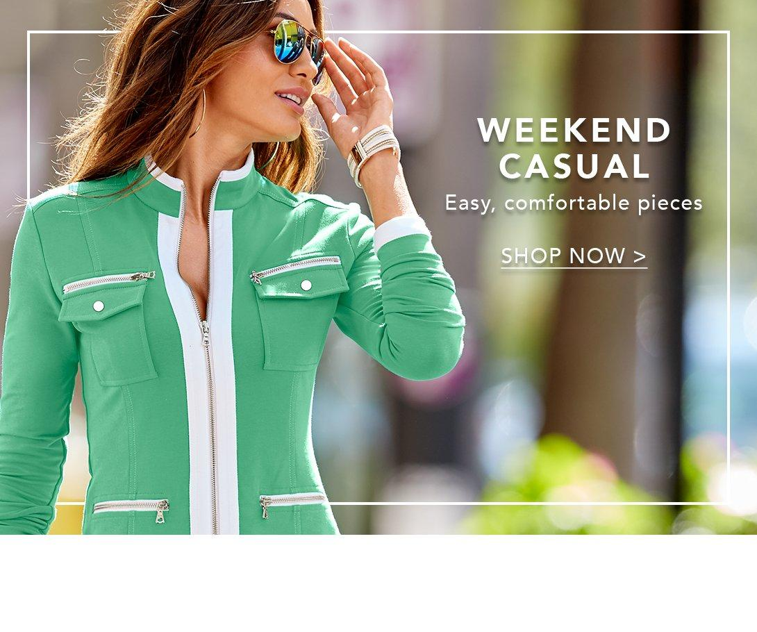model wearing chic zip warm up in green and mirrored aviator sunglasses.