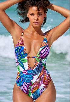 model wearing a floral print one-piece swimsuit with a plunging neckline.