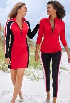 left model wearing a colorblock red, black, and white long sleeve sport dress. right model wearing a quarter zip red sport jacket and colorblock black, white, and red leggings.