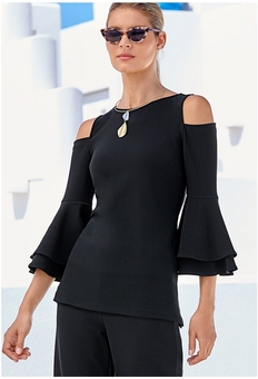 model wearing cold shoulder, flare-sleeve top, cat-eye sunglasses, gold necklace, and black pants.
