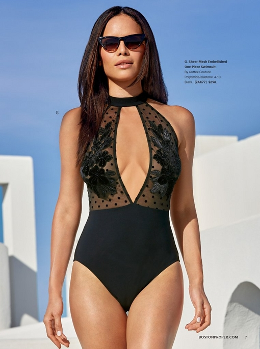model wearing a black sheer mesh embellished one-piece swimsuit with a large keyhole cut-out and cat-eye sunglasses.