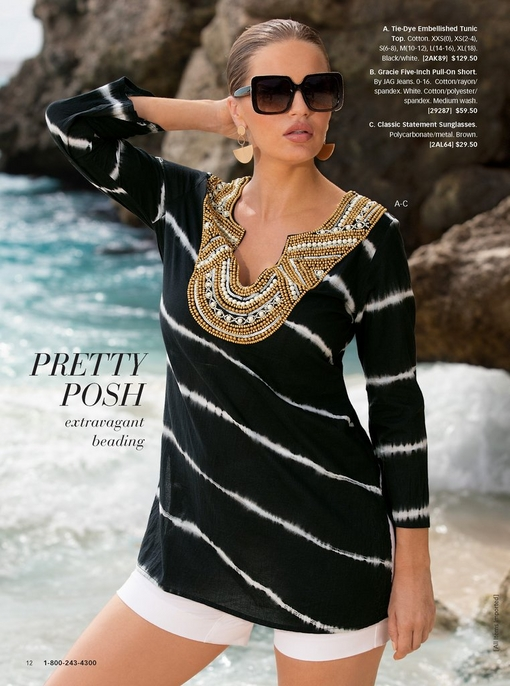 model wearing a black and white tie-dye tunic with a gold embellished neckline, white shorts, and tortoise sunglasses.