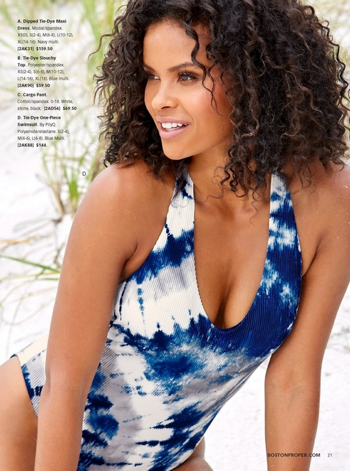 model wearing a blue and white tie-dye one-piece swimsuit.