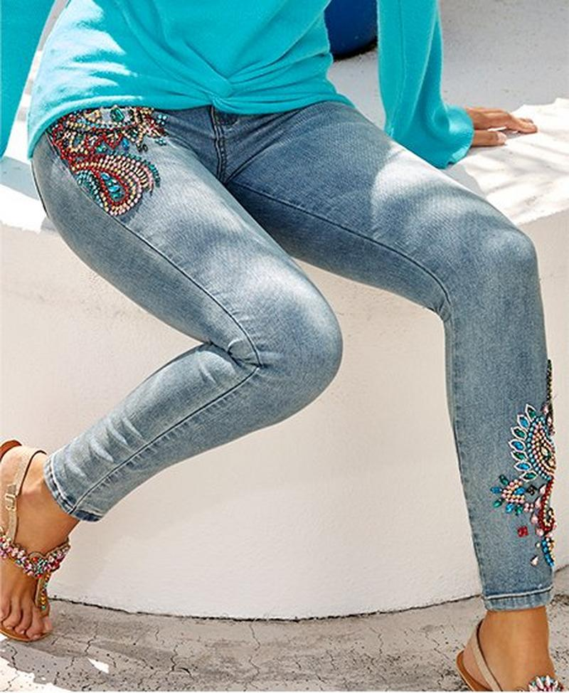 model wearing paisley embellished ankle jeans.