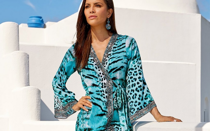 model wearing a blue animal print embellished kimono dress.