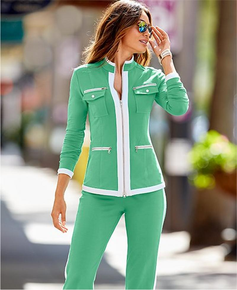 model wearing green chic zip warm-up with white piping.