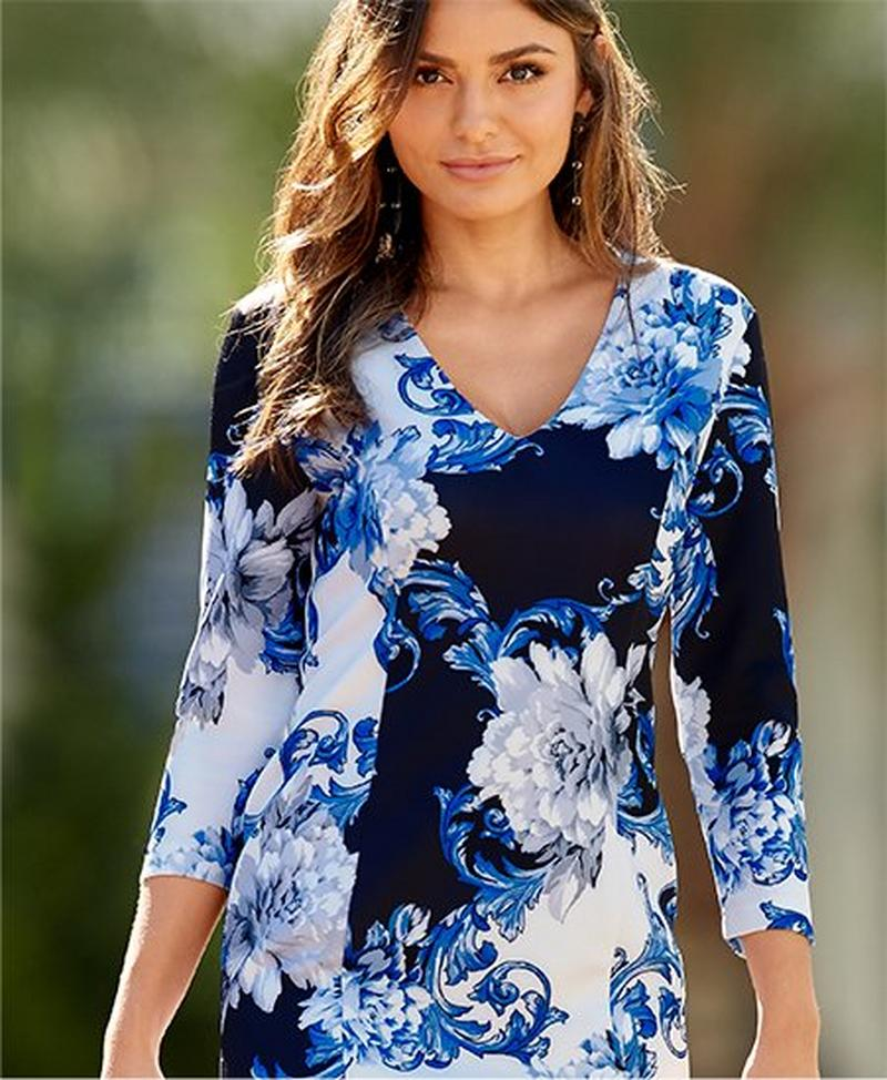 model wearing multiple shades of blue floral dress.