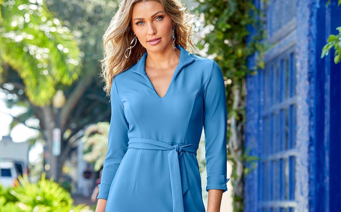 left model wearing animal print ruffle one-piece swimsuit. right model wearing leopard print high-neck midi dress.