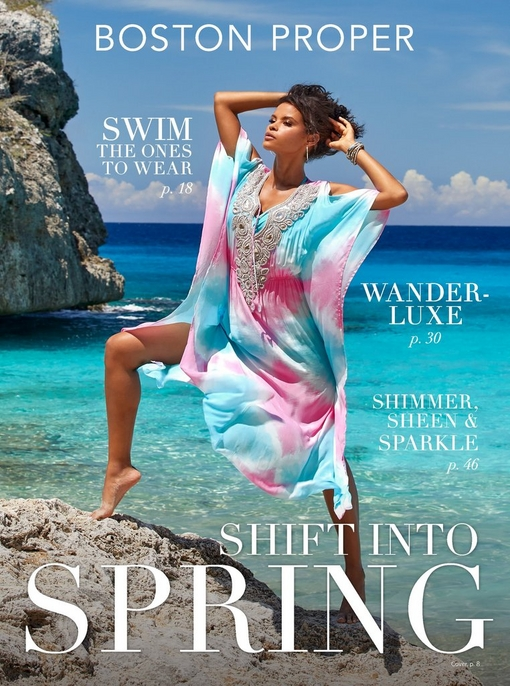 model wearing a pastel pink and blue embellished caftan white standing on a rocky beach.