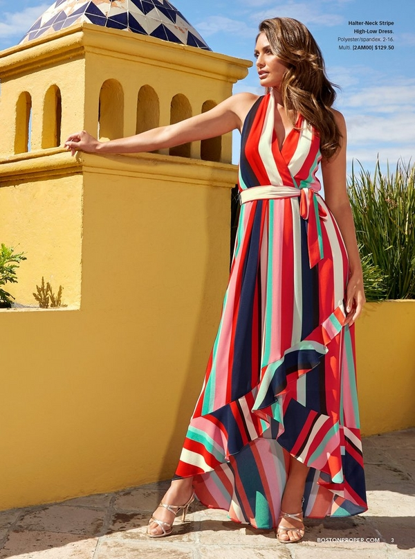 model wearing a halter-neck multicolored stripe high-low dress.