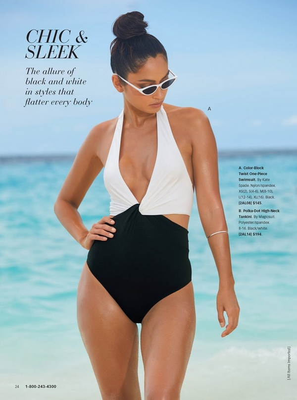 model standing on the beach wearing a color-block twist one-piece swimsuit in black and whtie with cat eye sunglasses.