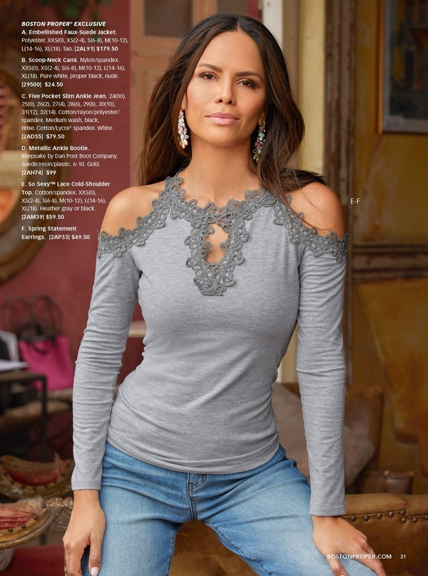 model wearing a gray lace cold-shoulder top and blue jeans with spring statement earrings.