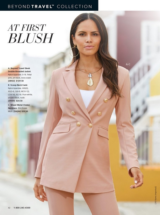model wearing a blush suit with a white tank top and metal choker necklace.