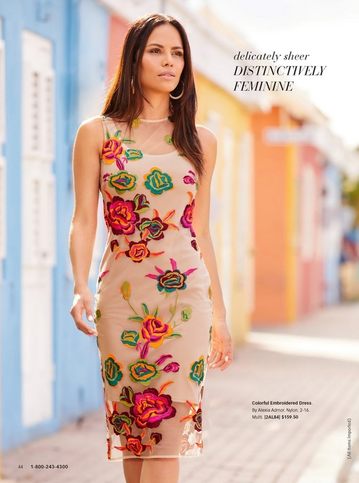 model wearing a mesh overlay nude dress with colorful embroidered flowers allover.