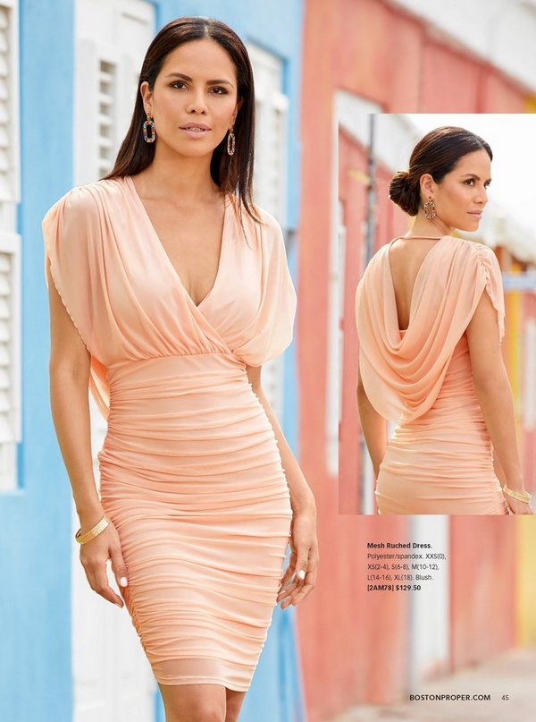 model wearing a mesh ruched dress in blush with a draped back.