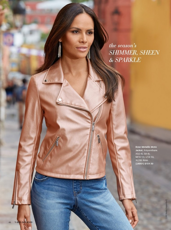 model wearing a metallic rose colored moto jacket, denim, and dangle earrings.
