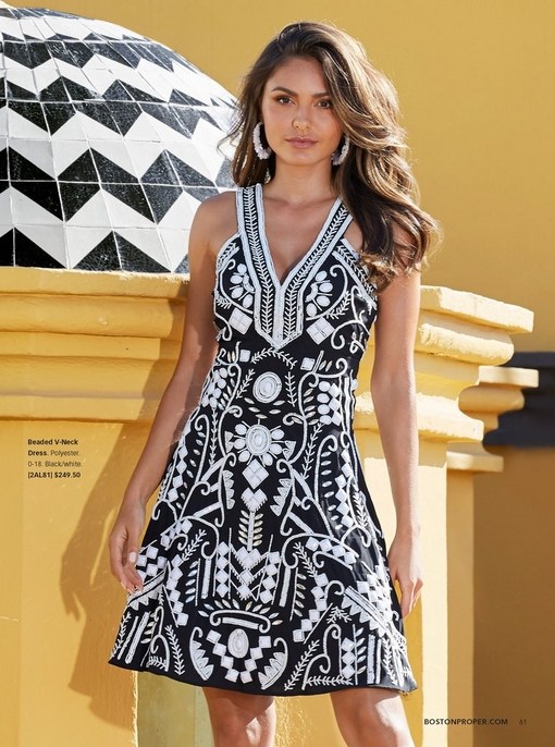 model wearing a black and white beaded v-neck dress.