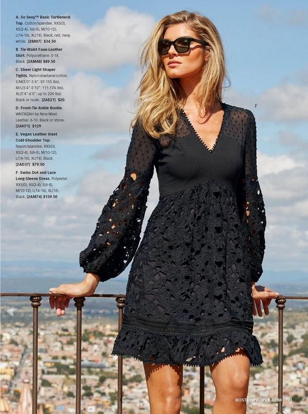 model wearing a black swiss dot and lace long-sleeve dress and black sunglasses