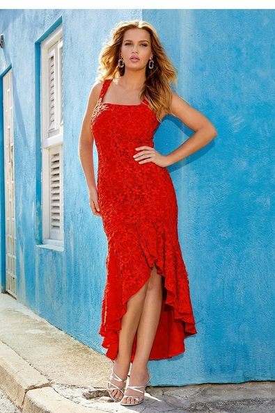 model wearing a red, ruffled, high-low dress and silver strappy heels.