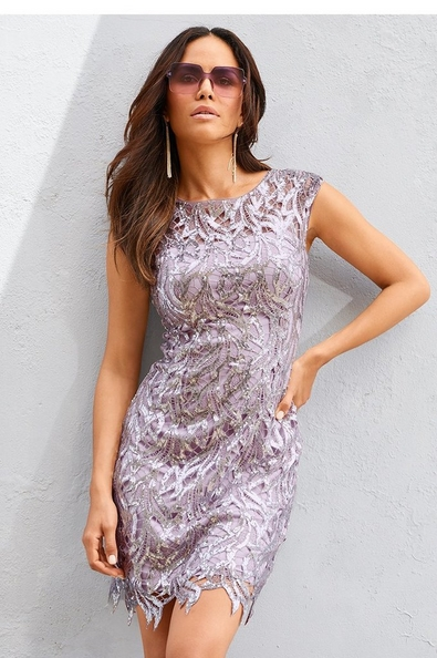 model wearing a purple sequin sleeveless dress with a lace overlay and purple sunglasses.