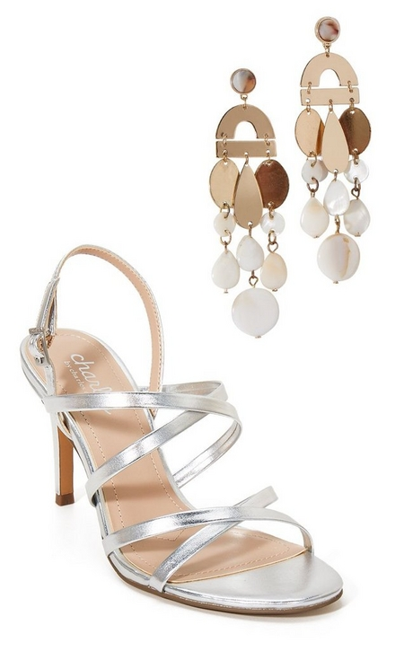 silos of tan dangle earrings and strappy silver heels.