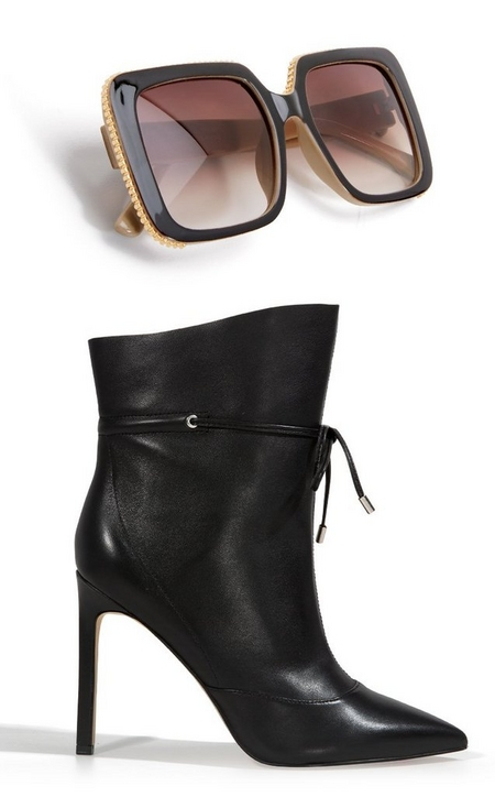 silo of statement sunglasses and black tie-front heeled booties.