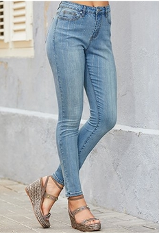 model wearing metallic pinstripe ankle jeans and metallic espadrille wedges.