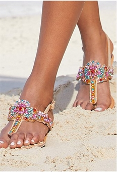 model wearing jewel embellished sandals.