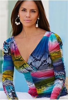 model wearing a ruched multicolored snake-print top.