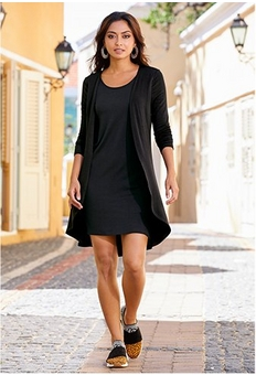 model wearing a black knit dress and duster combo.