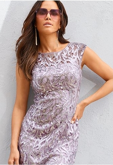 model wearing a purple sequin sleeveless dress and purple sunglasses.