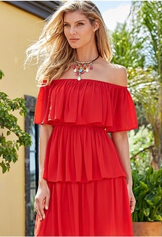 model wearing a red tiered ruffle off-the-shoulder dress and jewel choker necklace.