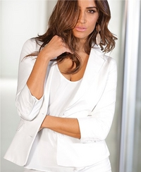 model wearing a white tank top and white blazer.