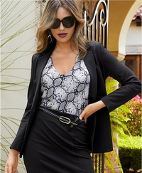 model wearing a gray snake print blouse, black pencil skirt,black blazer, and sunglasses.