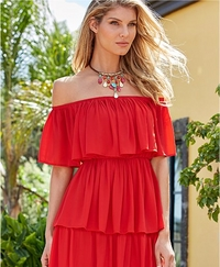 model wearing a red tiered ruffle off-the-shoulder dress and a jeweled choker necklace.