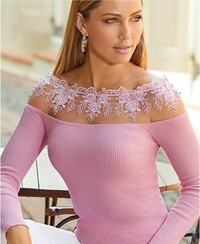 model wearing an off-the-shoulder pink lace illusion sweater.