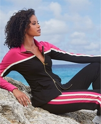 model wearing a black, white, and pink sport warm-up.