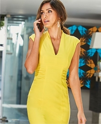 model wearing a yellow cap-sleeve v-neck dress.