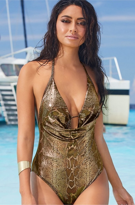 model wearing a gold, deep v, snake print swimsuit.