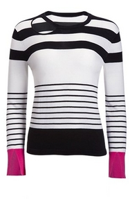 black and white striped sweater with pink accents.
