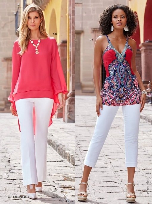 left model wearing a high-low, long-sleeve top in pink with white twill bootcut pants, gold necklace, and white vinyl heels. right model wearing a paisley print embellished sleeveless top with white twill capri pants.