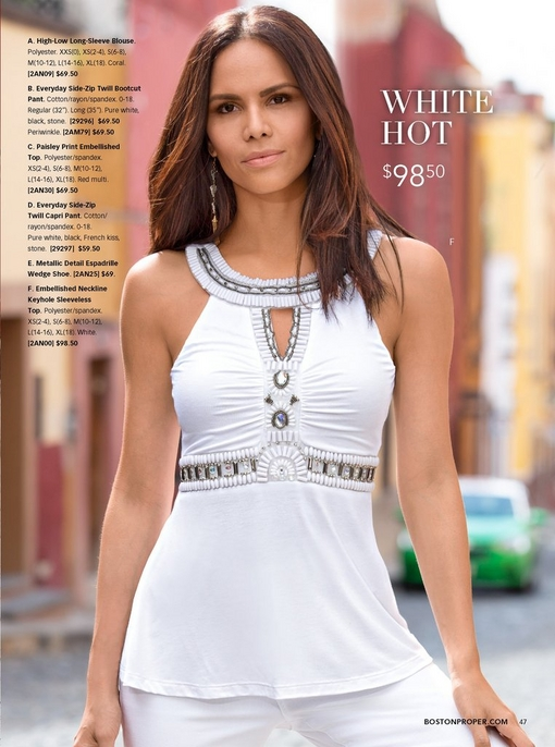 white embellished neckline keyhole sleeveless top and white jeans.