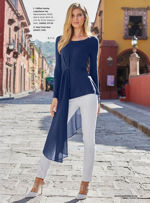 model wearing a navy blue chiffon overlay long-sleeve top with white pull-on jeans and white vinyl heels.