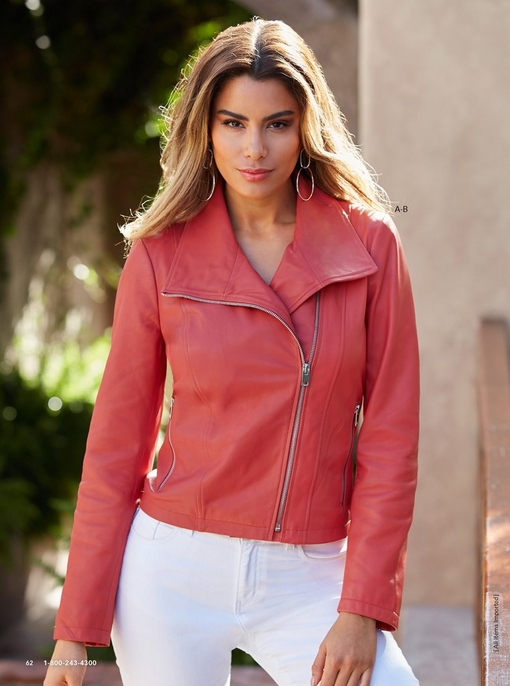model wearing a leather collared moto jacket in coral and white denim jeans.