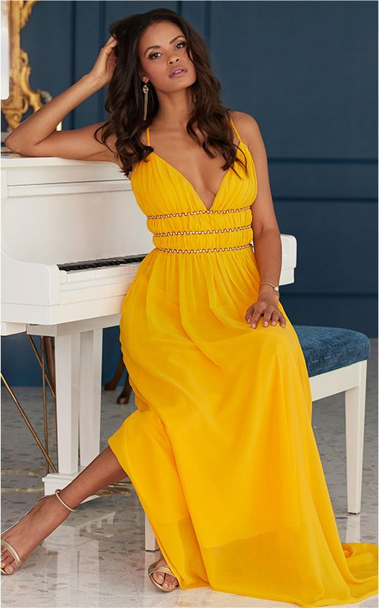 model wearing a yellow gold embellished maxi dress.